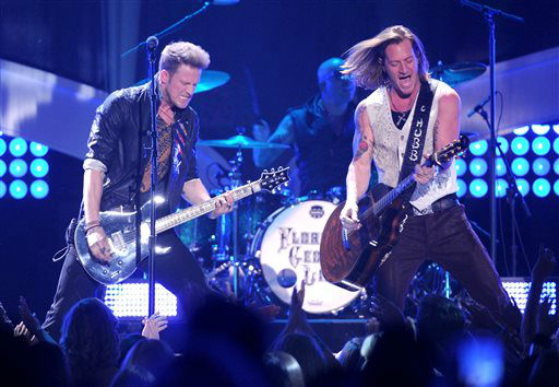 In this Dec. 10, 2013 photo, Brian Kelley, left, and Tyler Hubbard, of musical group Florida Georgia Line, perform at the American Country Awards at the Mandalay Bay Resort &amp; Casino, in Las Vegas.  Florida Georgia Line performs at Rodeo Houston on Wednesday, March 19, 2014.  &#40;Photo by Frank Micelotta&#47;Invision&#47;AP&#41; <span class=meta>(AP Photo&#47; Frank Micelotta)</span>