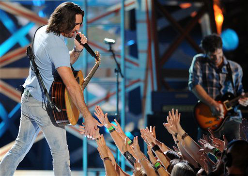 Jake Owen performs during the American Country Awards on Monday, Dec. 10, 2012, in Las Vegas.  Jake Owne performs at Rodeo Houston on Wednesday, March 12, 2014. &#40;Photo by Al Powers&#47;Powers Imagery&#47;Invision&#47;AP&#41; <span class=meta>(AP Photo&#47; Al Powers)</span>