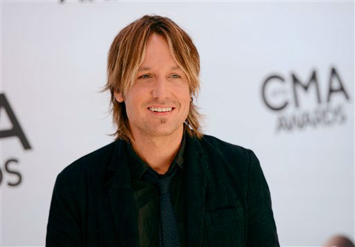 Keith Urban arrives at the 47th annual CMA Awards at Bridgestone Arena on Wednesday, Nov. 6, 2013, in Nashville, Tenn.  Keith Urban performs at Rodeo Houston on Friday, March 14, 2014. &#40;Photo by Evan Agostini&#47;Invision&#47;AP&#41; <span class=meta>(AP Photo)</span>