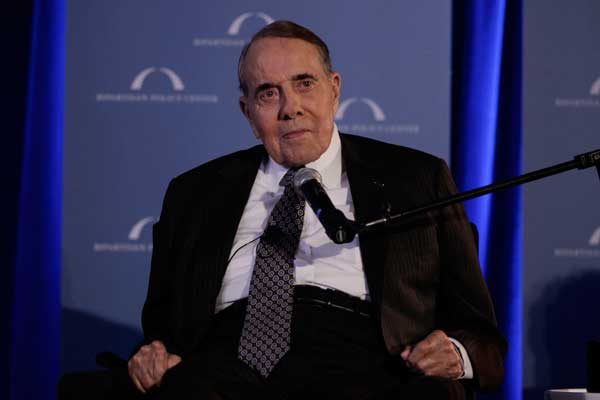 "Former U.S. Senate Majority Leader Bob Dole pauses as he speaks during ""A Century of Service"" honoring former U.S. Senate Majority Leaders Bob Dole and Howard Baker at Mellon Auditorium, Wednesday, March 21, 2012, in Washington. (AP Photo/Carolyn Kaster)"