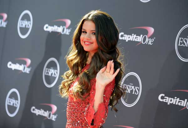 Singer Selena Gomez arrives at the ESPY Awards on Wednesday, July 17, 2013, at Nokia Theater in Los Angeles. (Photo by Jordan Strauss/Invision/AP)