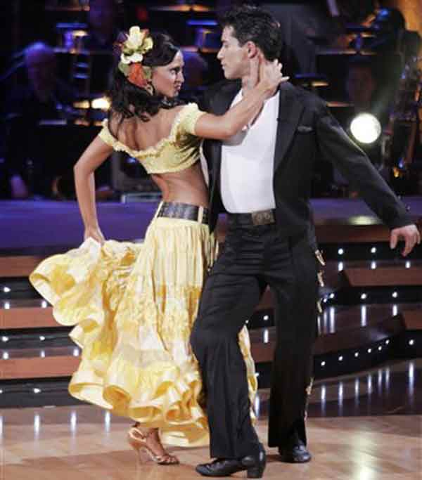 "In this photo made available by ABC, Mario Lopez dances with Karina Smirnoff, one of two teams that remain vying for the chance to be crowned champion of ""Dancing with the Stars,"" on Tuesday November 14,2006. (AP Photo/Adam Larkey)"