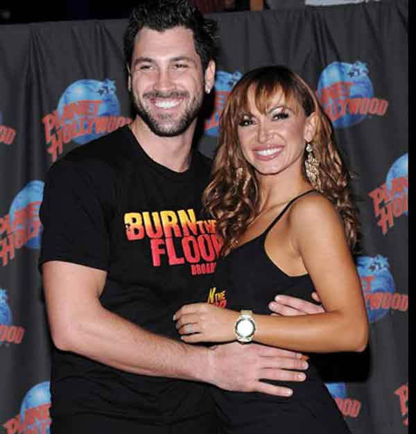 "In this Aug. 6, 2009 file photo, television personalities and professional dancers Maksim Chmerkovskiy, left, and Karina Smirnoff make an appearance to promote their new Broadway show ""Burn The Floor"" and to cast their footprints for display at Planet Hollywood Times Square in New York. (AP Photo/Evan Agostini, file)"