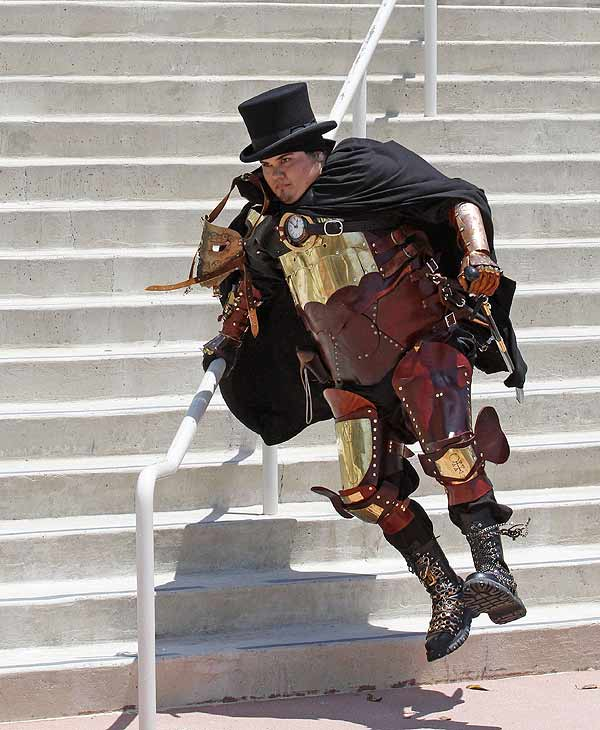 "Dressed as a character from the Jules Verne books series "" The Steampunks"" Andrew Connolly, jumps down the last of a long set of steps at Comic-Con International Saturday, July 24, 2010 in San Diego. (AP Photo/Denis Poroy)"