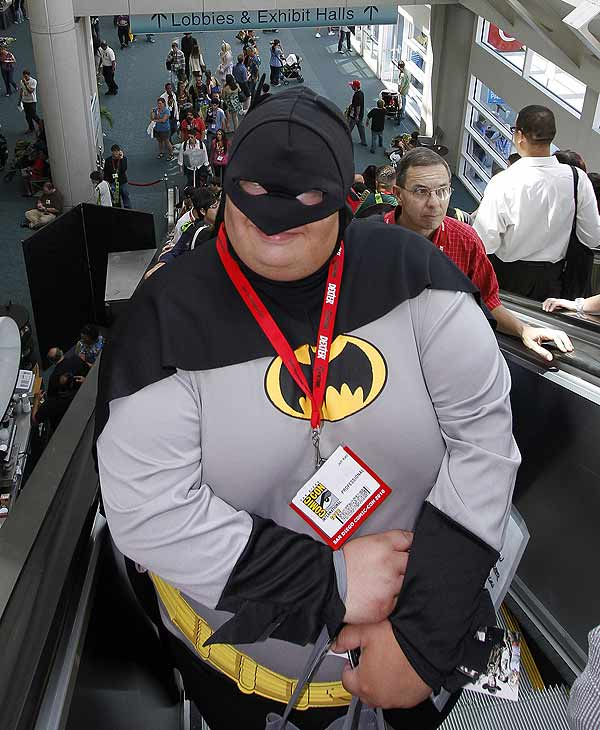 Evan Gordon, dressed as a Batman, rides the escalator during the second day of Comic-Con International Friday July 23, 2010 in San Diego. (AP Photo/Denis Poroy)
