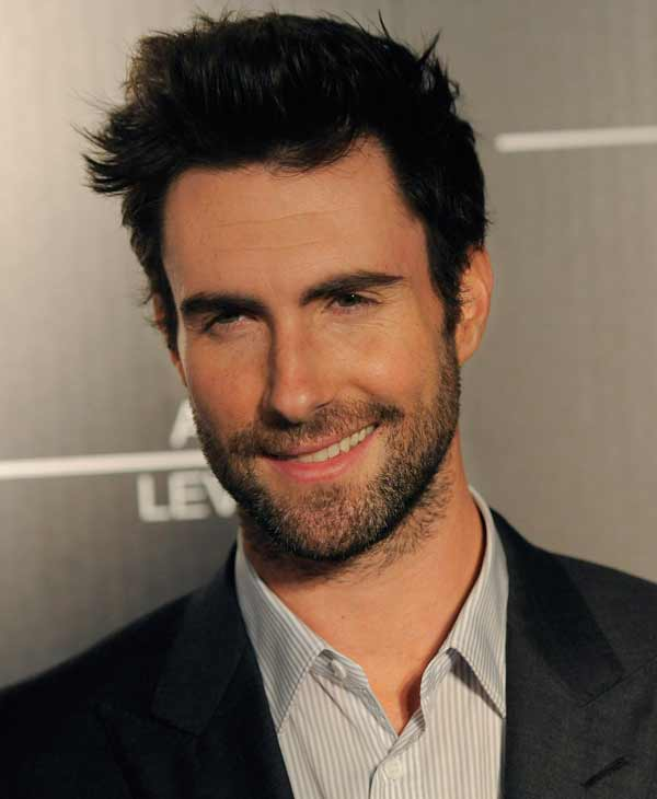 'Sexiest Man Alive' in 2013:  Singer Adam Levine poses at an event debuting his signature fragrances for men and women on Wednesday, Feb. 6, 2013 in Los Angeles. (Photo by Chris Pizzello/Invision/AP)