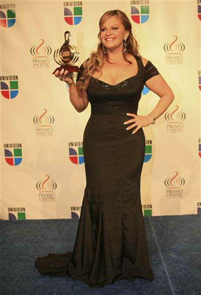 Jenni Rivera holds up her award for Female Artist of the Year in the Regional Mexican category backstage at the Premio lo Nuestro Latin Music Awards in Miami Thursday, Feb. 22, 2007. &#40;AP Photo&#47;Luis M. Alvarez&#41; <span class=meta>(Photo&#47;Luis M. Alvarez)</span>
