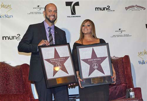 FILE - In this July 1, 2011 file photo, singer Jenni Rivera, right, and her husband, former Major League Baseball pitcher Esteban Loaiza, pose for a photograph with replicas of Las Vegas Walk of Stars presented to them during an official ceremony in Las Vegas. The couple, who married on Sept. 8, 2010, filed for divorce on Oct. 1, 2012. &#40;AP Photo&#47;Julie Jacobson, File&#41; <span class=meta>(Photo&#47;Julie Jacobson)</span>