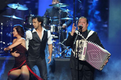 Pesado performs at  the 2012 Billboard Mexican Music Awards at the Shrine Auditorium on Thursday, Oct. 18, 2012, in Los Angeles.  Pesado performs at Rodeo Houston on Saturday, March 16, 2014. &#40;Photo by J. Emilio Flores&#47;Invision&#47;AP&#41; <span class=meta>(AP Photo&#47; J. Emilio Flores)</span>