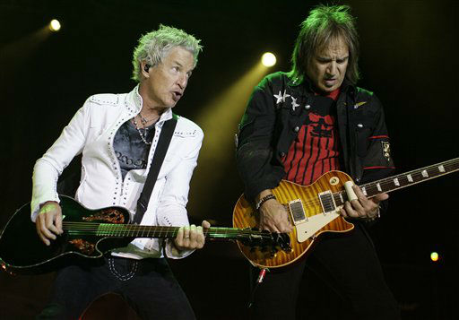 Lead singer Kevin Cronin, left, and guitarist Dave Amato, right, perform during a rock concert by the group REO Speedwagon, in Paso Robles, Calif., Saturday, July 25, 2009.  REO Speedwagon performs at Rodeo Houston on Monday, March 10, 2014.  &#40;AP Photo&#47;Michael A. Mariant&#41; <span class=meta>(AP Photo&#47; Michael A. Mariant)</span>