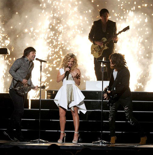 From left, Neil Perry, Kimberly Perry and Reid Perry of &#39;The Band Perry&#39; perform onstage at The 47th Annual CMA Awards, on Wednesday, November 6, 2013 at Bridgestone Arena in Nashville, Tenn.  &#39;The Band Perry&#39; performs at Rodeo Houston on Saturday, March 22, 2014. &#40;Photo by Frank Micelotta&#47;Invision&#47;AP Images&#41; <span class=meta>(AP Photo)</span>