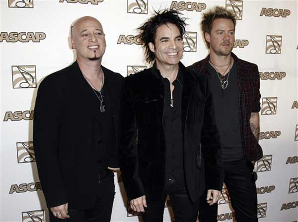 The band Train, from left Jimmy Stafford, Pat Monahan and Scott Underwood, arrives at the 28th Annual ASCAP Pop Music Awards in Los Angeles, Wednesday, April 27, 2011. The ASCAP awards honor songwriters and publishers of the most performed songs of 2010. (AP Photo/Matt Sayles)