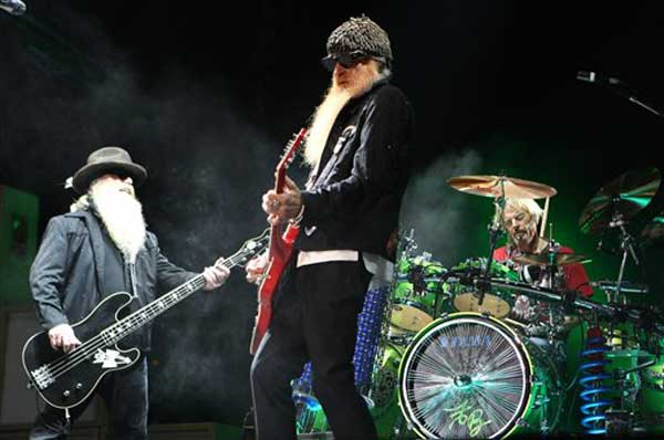 Left to right, Dusty Hill, Billy Gibbons and Frank Beard of American blues rock trio, ZZ Top, perform during their open-air concert, in front of The Prince's Palace of Monaco, Monday, July 5, 2010, in Monaco.(AP Photo/Lionel Cironneau)