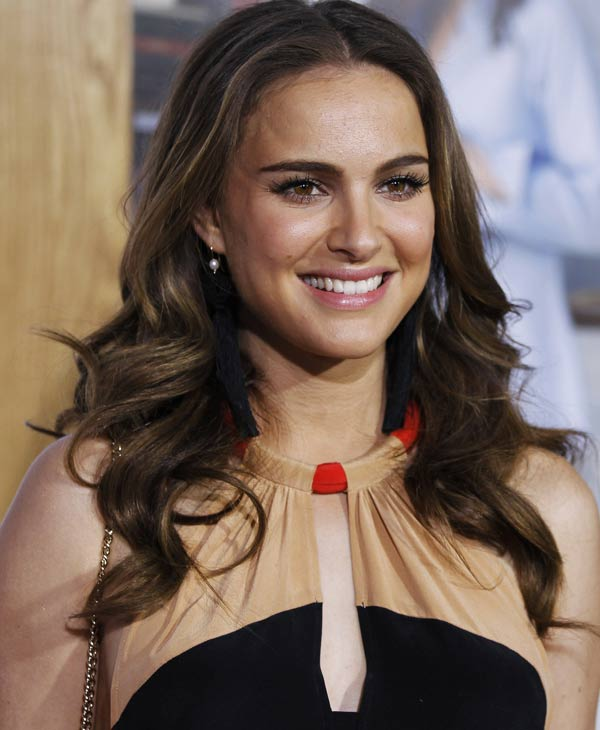 "In this Jan. 11, 2011 file photo, Natalie Portman arrives at the premiere ""No Strings Attached"" in Los Angeles. Portman was nominated for an Academy Award for best actress for her role in ""Black Swan,"" Tuesday, Jan. 25, 2011. The Oscars will be presented Feb. 27 at the Kodak Theatre in Hollywood. (AP Photo/Matt Sayles)"