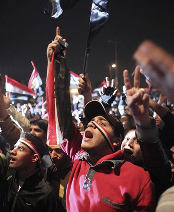 "<div class=""meta image-caption""><div class=""origin-logo origin-image ""><span></span></div><span class=""caption-text"">Egyptians celebrate the news of the resignation of President Hosni Mubarak, who handed control of the country to the military, at night in Tahrir Square in downtown Cairo, Egypt Friday, Feb. 11, 2011. (AP Photo/Tara Todras-Whitehill)</span></div>"