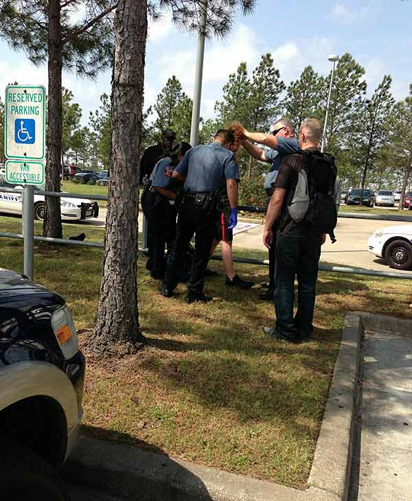 "<div class=""meta ""><span class=""caption-text "">An ABC13 viewer took this photo of police taking the alleged Lone Star College Cy-Fair stabbing suspect into custody. (KTRK/Steven M.)</span></div>"