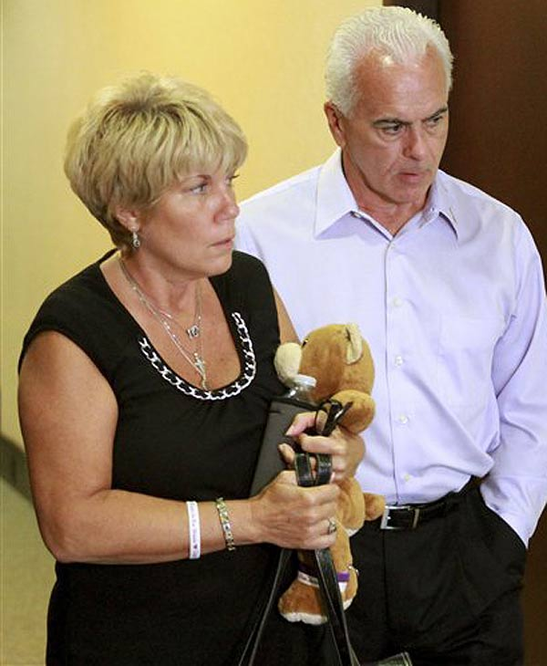 Cindy Anthony, holding a teddy bear, and her husband, George Anthony, leave the courtroom after listening to the first part of the state's opening arguments in their daughter's first-degree murder trial, at the Orange County Courthouse, in Orlando, Fla., Tuesday, May 24, 2011. Their daughter, Casey Anthony, is on trial for the murder of her 2-year-old daughter. (AP Photo/Joe Burbank, Pool)