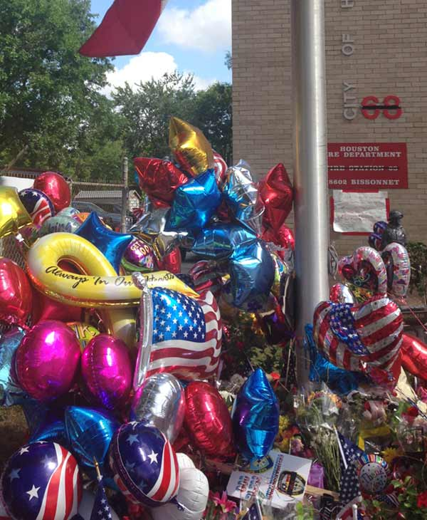 Many Houstonians have left behind balloons, flowers and notes at the Houston Fire Station No. 68.  Firefighter EMT Robert Garner, 29 and  Probationary Firefighter Anne Sullivan, 24, of Station 68 both died while battling last week&#39;s motel fire. <span class=meta>(ABC13&#47;Elissa Rivas)</span>