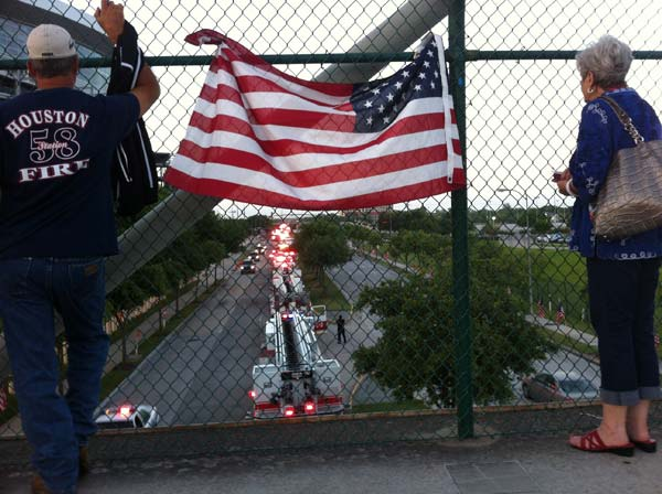 "<div class=""meta image-caption""><div class=""origin-logo origin-image ""><span></span></div><span class=""caption-text"">Just outside Reliant Stadium, as firefighters arrive this morning for the firefighter memorial service (ABC13/John Mizwa)</span></div>"