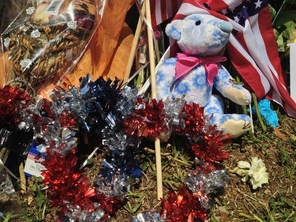 "<div class=""meta image-caption""><div class=""origin-logo origin-image ""><span></span></div><span class=""caption-text"">Many residents have left behind items at Station 68 to pay tribute to the fallen firefighters (ABC13/John Mizwa)</span></div>"