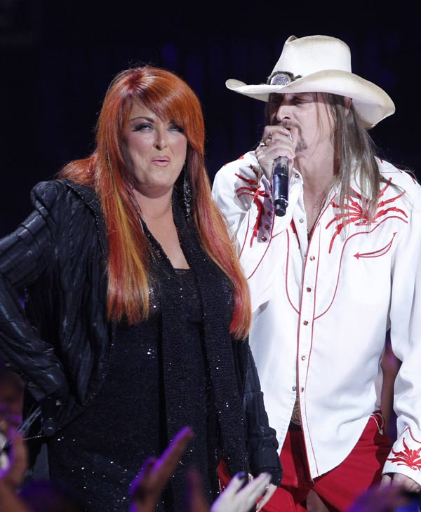 Wynonna Judd and Kid Rock appear on stage the 2011 CMT Music Awards in Nashville, Tenn. on Wednesday, June 8, 2011. (AP Photo/Dave Martin)