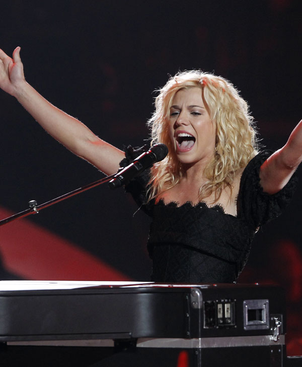 Kimberly Perry from The Band Perry performs on stage the 2011 CMT Music Awards in Nashville, Tenn. on Wednesday, June 8, 2011. (AP Photo/Dave Martin)