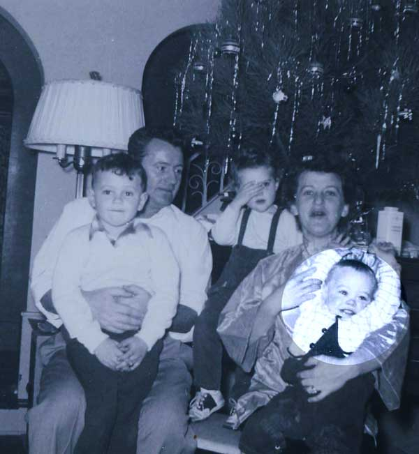 "<div class=""meta ""><span class=""caption-text "">Anchor Tom Koch (spotlighted in image above on his mother's lap) with his family, including his father, Henry (Tom Koch)</span></div>"