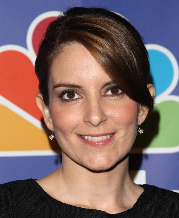 "In this May 17, 2010 file photo, actress Tina Fey attends the NBC Universal's Upfront presentation in New York. Fey was nominated for an Emmy for best actress in a comedy on Thursday, July 8, 2010 for her role in ""30 Rock."" The 62nd Primetime Emmy Awards will be held on Sunday, Aug. 29, in Los Angeles. (AP Photo/Peter Kramer, file)"