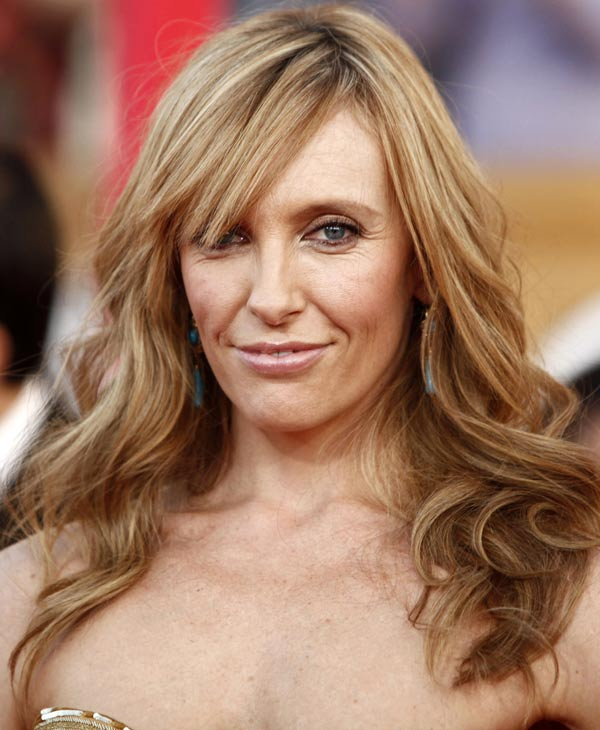 "In this Jan. 23, 2010 file photo, actress Toni Collette arrives at the 16th Annual Screen Actors Guild Awards in Los Angeles. Collette was nominated for an Emmy on Thursday, July 7, 2010, for lead actress in a comedy series for her role in ""United States of Tara."" The 62nd Primetime Emmy Awards will be held on Sunday, Aug. 29. (AP Photo/Matt Sayles, file)"