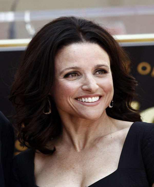 "In this May 4, 2010 file photo, actress Julia Louis-Dreyfus poses after the dedication ceremony for her Star on the Hollywood Walk of Fame in Los Angeles. Louis-Dreyfus was nominated for an Emmy, Thursday, July 8, 2010 for best actress in a comedy series for her role in ""The New Adventures of Old Christine."" The 62nd Primetime Emmy Awards will be held on Sunday, Aug. 29. (AP Photo/Matt Sayles)"