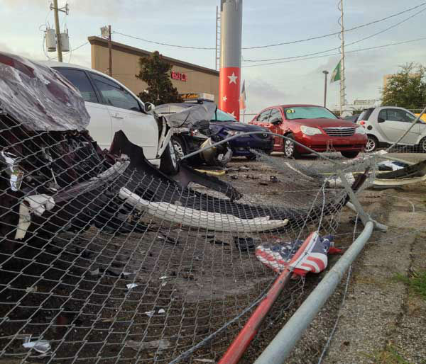 Several cars at the All Star Motors dealership were damaged in the accident