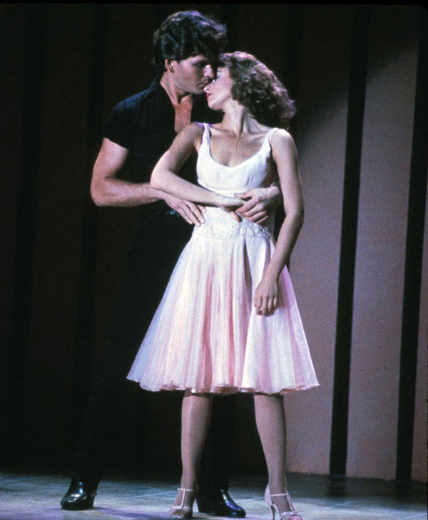 "In this image provided by Lionsgate Home Entertainment, Patrick Swayze, portraying Johnny Castle, and Jennifer Grey, portraying Baby Houseman, are shown in a scene from the film, ""Dirty Dancing."" Swayze's publicist Annett Wolf says the 57-year-old ""Dirty Dancing"" actor died Monday, Sept. 14, 2009, after a nearly two-year battle with pancreatic cancer. (AP Photo/Lionsgate Home Entertainment)"