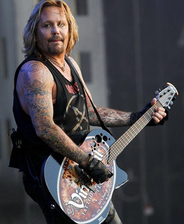 In this Aug. 5, 2010 file photo, singer Vince Neil performs at the Wacken Open Air Festival in Wacken, Schleswig Holstein, northern Germany. (AP Photo/Axel Heimken)