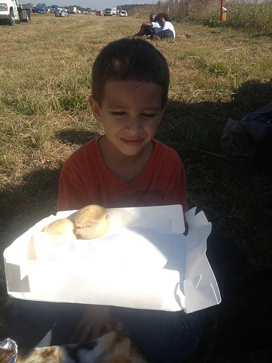 Damien Ortiz, 5, got his mother's permission to serve turkey sandwiches to the other victims of the pileup after their vehicle was hit by a jack-knifed semi.  They were taking turkey dinner to surprise loved ones in Louisiana.