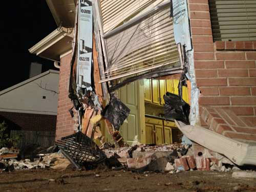 Photos from the home that was damaged early Tuesday in northwest Harris County when a driver slammed into it <span class=meta>(Photo&#47;John Mizwa)</span>