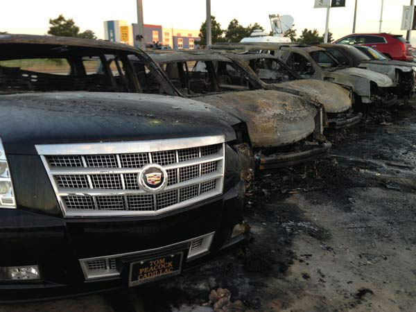"<div class=""meta image-caption""><div class=""origin-logo origin-image ""><span></span></div><span class=""caption-text"">Several vehicles at a north Houston dealership were destroyed or damaged by intense flames. (ABC-13)</span></div>"