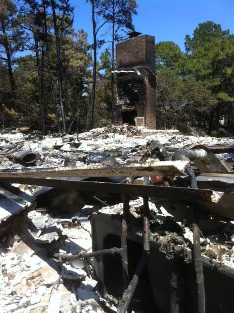 "<div class=""meta ""><span class=""caption-text "">Remains of a home off Kona Road in Bastrop, Texas (From Kevin Quinn)</span></div>"