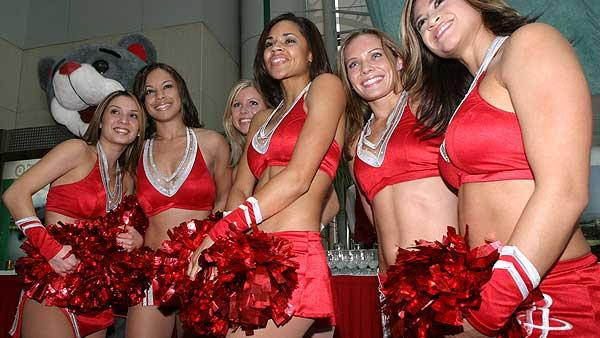 Members of the NBA Houston Rockets Power Dancers dance team pose after performing at the announcement of a multi-year marketing agreement between the NBA and Red Bull in Beijing Tuesday, Nov. 25, 2003.  (AP)
