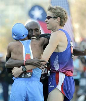 "<div class=""meta ""><span class=""caption-text "">The top three men, Ryan Hall, right, Meb Keflezighi, left, and Abdi Abdirahman, center, hug  after running the U.S. Olympic Trials Marathon Saturday, Jan. 14, 2012, in Houston. (AP Photo/David J. Phillip) (AP Photo/ David J. Phillip)</span></div>"