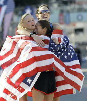 "<div class=""meta image-caption""><div class=""origin-logo origin-image ""><span></span></div><span class=""caption-text"">The top three women finishers, from left, Shalane Flanagan, first, Desiree Davila, second, and Kara Goucher, third, embrace after running in the U.S. Olympic Trials Marathon, Saturday, Jan. 14, 2012, in Houston. (AP Photo/David J. Phillip) (AP Photo/ David J. Phillip)</span></div>"