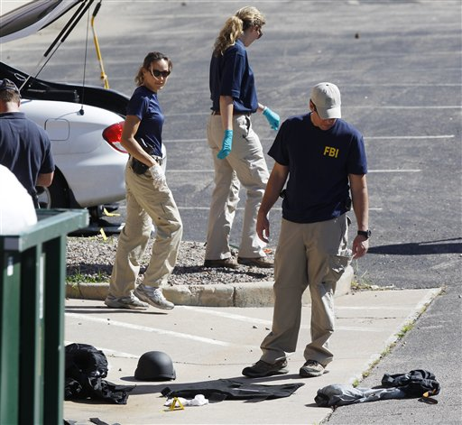 "<div class=""meta ""><span class=""caption-text "">Investigators look over evidence on ground outside the back door of the Century 16 movie theater east of the Aurora Mall in Aurora, Colo. on Friday, July 20, 2012. A gunman in a gas mask barged into a crowded Denver-area theater during a midnight showing of the Batman movie on Friday, hurled a gas canister and then opened fire in one of the deadliest mass shootings in recent U.S. history. (AP Photo/David Zalubowski)</span></div>"