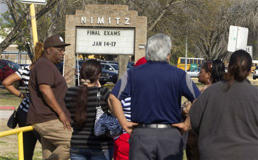 Parents wait to pick up their children outside Nimitz High School after it was placed on lockdown after a shooting happened nearby on Lone Star College North Harris campus on Tuesday, Jan. 22, 2013 in Houston. The shooting wounded three people and sent students fleeing for safety as officials placed the college campus on lockdown, officials said. Harris County Sheriff&#39;s Maj. Armando Tello said authorities had detained a person of interest. Police did not provide any details about the people who were wounded.   <span class=meta>(AP Photo&#47; Patric Schneider)</span>