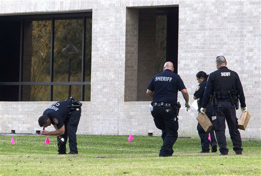 "<div class=""meta ""><span class=""caption-text "">Police collect evidence after a shooting happened on Lone Star College North Harris campus on Tuesday January 22, in Houston. The shooting at a community college wounded three people Tuesday and sent some students fleeing for safety while others with medical training helped tend the wounded.     (AP Photo/ Patric Schneider)</span></div>"