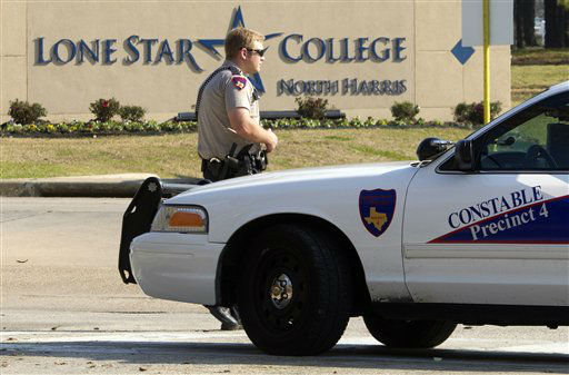 A Harris Precinct 4 Constable blocks off an entrance to the Lone Star College North Harris campus after a shooting on Tuesday, Jan. 22, 2013 in Houston. The shooting on campus wounded three people and sent students fleeing for safety as officials placed the campus on lockdown, officials said. Harris County Sheriff&#39;s Maj. Armando Tello said authorities had detained a person of interest. Police did not provide any details about the people who were wounded.    <span class=meta>(AP Photo&#47; Patric Schneider)</span>