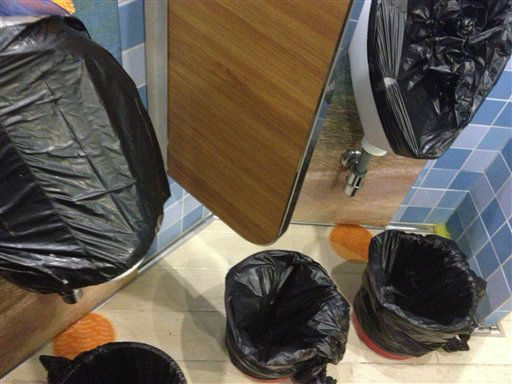 "<div class=""meta ""><span class=""caption-text "">This undated photo provided by passenger Don Hoggatt, of Dallas, shows covered urinals and bagged trash cans for passengers to use in one of the bathrooms aboard the Carnival Triumph cruise ship which became disabled after an engine-room fire left the ship powerless off Mexico last weekend. The Triumph arrived late Thursday, Feb. 14, 2013, in Mobile, Ala., after an engine-room fire left the ship powerless off Mexico last weekend.   (AP Photo/ Don Hoggatt)</span></div>"
