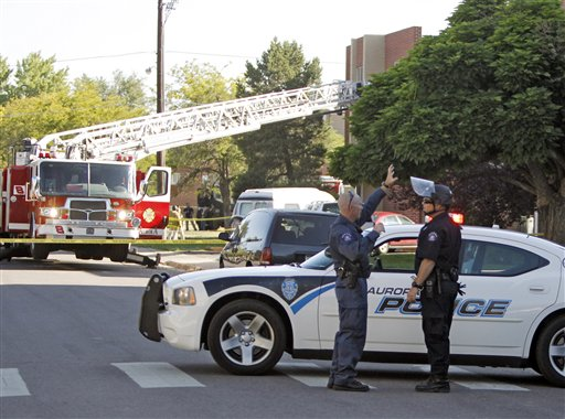 "<div class=""meta ""><span class=""caption-text "">Police block the road in front of an apartment where the suspect in a theatre shooting lived in Aurora, Colo., on Friday, July 20, 2012. As many as 12 people were killed and 50 injured at a shooting at the Century 16 movie theatre on Friday. The suspect is identified as 24-year-old James Holmes. (AP Photo/Ed Andrieski)</span></div>"