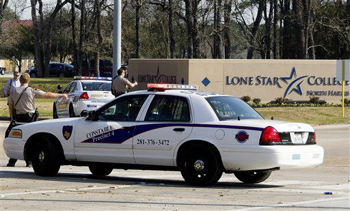 Police block off an entrance to the Lone Star College North Harris campus after a shooting on Tuesday, Jan. 22, 2013 in Houston. The shooting on campus wounded three people and sent students fleeing for safety as officials placed the campus on lockdown, officials said. Harris County Sheriff&#39;s Maj. Armando Tello said authorities had detained a person of interest. Police did not provide any details about the people who were wounded.    <span class=meta>(AP Photo&#47; Patric Schneider)</span>