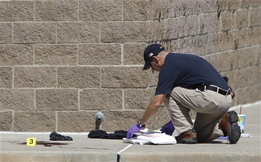 "<div class=""meta ""><span class=""caption-text "">An investigator inspects evidence outside the Century 16 movie theater east of the Aurora Mall in Aurora, Colo. on Friday, July 20, 2012. A gunman in a gas mask barged into the crowded Denver-area theater during a midnight showing of the Batman movie on Friday, hurled a gas canister and then opened fire in one of the deadliest mass shootings in recent U.S. history. (AP Photo/David Zalubowski)</span></div>"