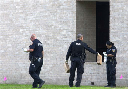 Police collect evidence after a shooting happened on Lone Star College North Harris campus on Tuesday January 22, in Houston. The shooting at a community college wounded three people Tuesday and sent some students fleeing for safety while others with medical training helped tend the wounded.    <span class=meta>(AP Photo&#47; Patric Schneider)</span>