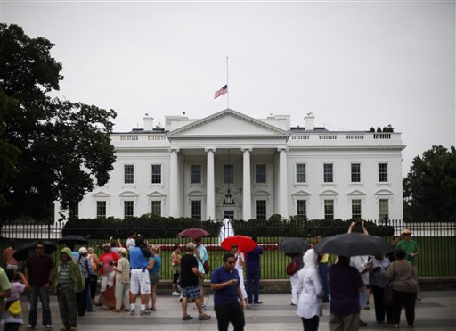 The American flag is seen at half-staff over the White House in Washington, Friday, July 20, 2012. President Barack Obama, who cut short his campaign stop in Florida, order the flag to be lowered in the aftermath of the tragic mass shooting at a movie theater in Aurora, Colo.(AP Photo/Pablo Martinez Monsivais)